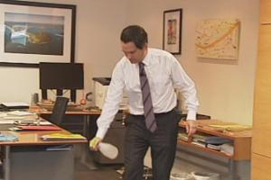 SImon Bridges spraying the floor in his office with water